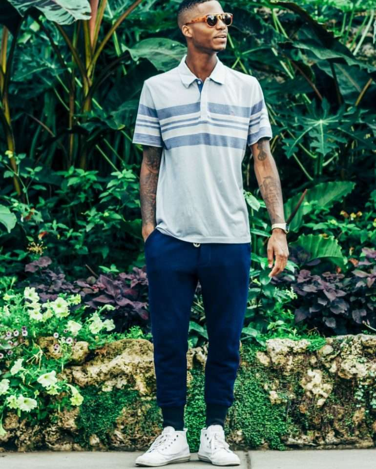 A man wears navy joggers with plimsolls and a short-sleeved shirt PHOTO CREDIT: Pinterest